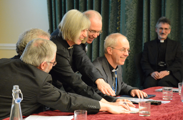 The Archbishop of Canterbury and representatives of other member churches press the button to launch the Churches Mutual Credit Union
